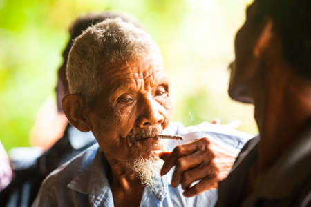 jah: BERDUT, MALAYSIA - APR 8: Unidentified old man Orang Asli in his village on Apr 8, 2013 in Berdut, Malaysia. More than 76% of all Orang Asli live below the poverty line, life expectancy - 53 years old.