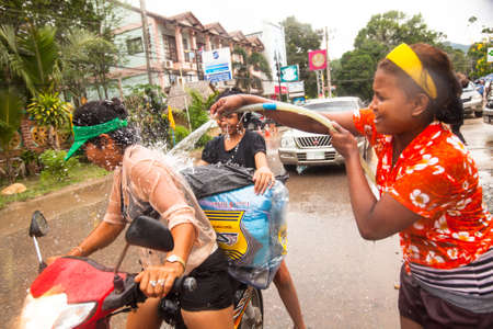 watergun: KO CHANG, THAILAND - APR 14: People celebrated Songkran Festival, on 14 Apr 2013 on Ko Chang, Thailand. Songkran is celebrated in Thailand as the traditional New Years Day from 13 to 16 April.