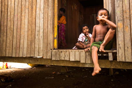 jah: BERDUT, MALAYSIA - APR 8: Unidentified children Orang Asli in his village on Apr 8, 2013 in Berdut, Malaysia. More than 76% of all Orang Asli live below the poverty line, life expectancy - 53 years old.