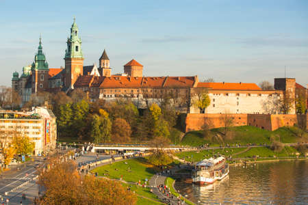 KRAKOW, POLAND - OCT 20, 2013: View of Royal Wawel castle with park. The monument to the history of the Decree of the President Lech Walesa on Sep 8, 1994.