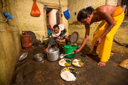 sanskrit: KATHMANDU, NEPAL - DEC 9, 2013: Unknown children during dinner at Jagadguru School. School established at 2013, to let new generation learn Sanskrit and preserve Hindu culture. Editorial