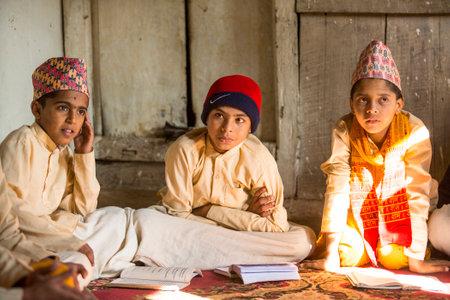 sanskrit: KATHMANDU, NEPAL - DEC 9, 2013: Unknown children during the reading of texts in Sanskrit at Jagadguru School. School established at 2013 to let preserve Hindu culture.