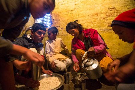 sanskrit: KATHMANDU, NEPAL - DEC 9, 2013: Unknown children during lunch at Jagadguru School. School established at 2013, to let new generation learn Sanskrit and preserve Hindu culture. Editorial