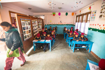 KATHMANDU, NEPAL - DEC 24, 2013: Unknown pupils in English class at primary school. Only 50% of  children in Nepal can reach 5 grade.