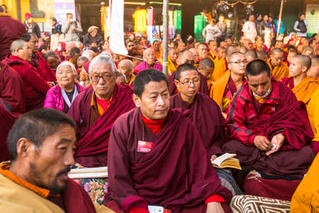 KHATMANDU, NEPAL - DEC 15, 2013: Unidentified tibetan Buddhist monks near stupa Boudhanath during festive Puja of H.H. Drubwang Padma Norbu Rinpoches reincarnations.