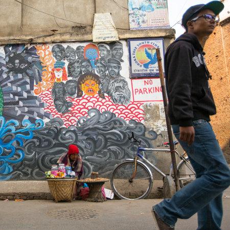 KATHMANDU, NEPAL - DEC 19, 2013: Unidentified street vendor in historic center of city. Largest city of Nepal, its economic center, a population of over 1 million people.