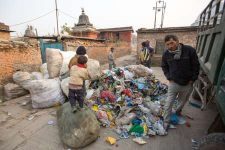 poorer: KATHMANDU, NEPAL - DEC 19, 2013: Unidentified people from poorer areas working in sorting of plastic on the dump. Only 35% of population have access to adequate sanitation.
