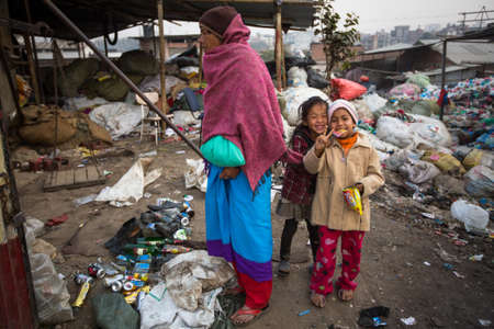 rigid: KATHMANDU, NEPAL - DEC 19, 2013: Unidentified local children near their homes in a poor area of the city. The caste system is still intact today but the rules are not as rigid as they were in the past