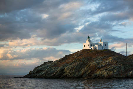 Lighthouse on the island in the Aegean Sea photo