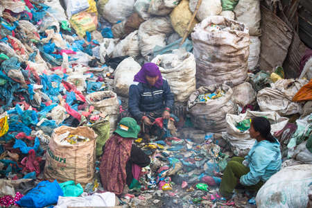 poorer: KATHMANDU, NEPAL - DEC 19: Unidentified people from poorer areas working in sorting of plastic on the dump, Dec 19, 2013 in Kathmandu, Nepal. Only 35% of population have access to adequate sanitation.