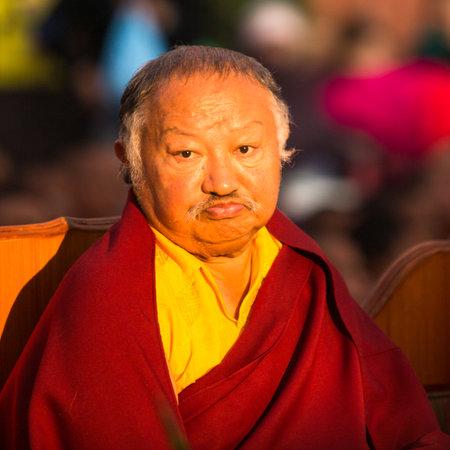 padma: KHATMANDU, NEPAL - DEC 17: Unidentified tibetan Buddhist monk near stupa Boudhanath during festive Puja of H.H. Drubwang Padma Norbu Rinpoches reincarnations, Dec 17, 2013 in Khatmandu, Nepal.