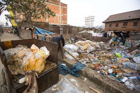 poorer: KATHMANDU, NEPAL - DEC 19: Unidentified people from poorer areas working in sorting of plastic on the dump, Dec 19, 2013 in Kathmandu, Nepal. Only 35% of population have access to adequate sanitation.