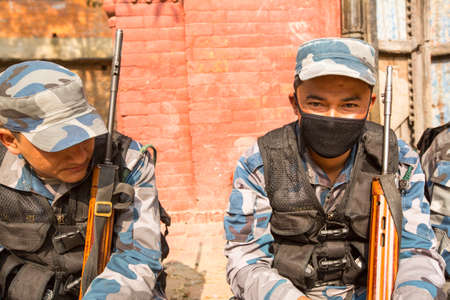 roster: KATHMANDU, NEPAL - Oct 19: Unknown nepalese soldiers Armed Police Force near public school, Dec 19, 2013 in Kathmandu, Nepal. Initially founded with a roster of 15,000 police and military personnel.