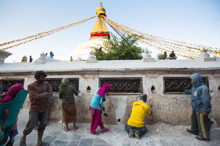 stupa one: KATHMANDU, NEPAL - DEC 3: Unidentified workers repairing of Stupa Boudhanath, Dec 3, 2013 in Kathmandu, Nepal. Stupa is one of the largest in the world, of 1979 is a UNESCO World Heritage Site. Editorial