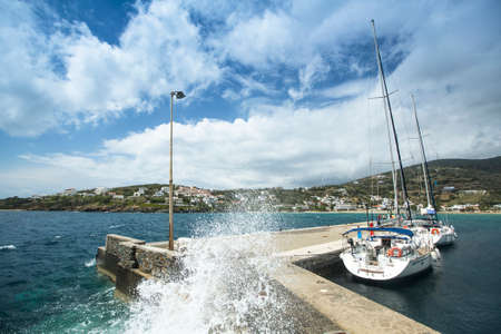 andros: ANDROS, GREECE - APR 28, 2014: Marina of Andros, is the northernmost island of the Greek Cyclades archipelago in the Aegean Sea - area is 380 km2, 40 km long, and its greatest breadth is 16 km. Editorial