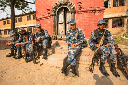 tasked: KATHMANDU, NEPAL - Oct 19: Unknown nepalese soldiers Armed Police Force near the public school, Dec 19, 2013 in Kathmandu, Nepal. Armed Police Force tasked with counterinsurgency operations in Nepal.
