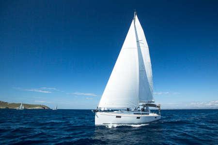 regatta: Boat in sailing regatta. Luxury yachts.