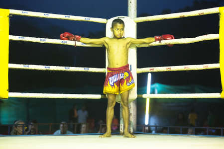 saia: CHANG, THAILAND - FEB 22: Unidentified young Muaythai fighter in ring during match, Feb 22, 2013 on Chang, Thailand. For many Thai men, Muaythai only way to break out of poverty, per battle pay to 7000 baht. Editorial