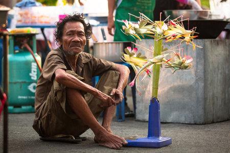 AYUTTHAYA, THAILAND - MAR 11: An unidentified beggar sells handicrafts near Ayutthaya Historical Park on Mar 11, 2012 in Ayutthaya, Thailand. Park is the ruins is a very popular tourist destination. Editorial