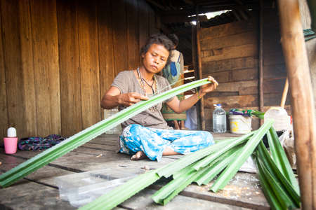 jah: BERDUT, MALAYSIA - APR 8: Unidentified woman Orang Asli in his village on Apr 8, 2013 in Berdut, Malaysia. More than 76% of all Orang Asli live below the poverty line, life expectancy - 53 years old.