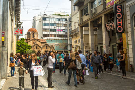 athenians: ATHENS, GREECE - MAY 10, 2014: Athenians and tourists in center of city. Tourism is a decisive sector of hope for Greek economy - In the year Greece receives about 18 million tourists. Editorial