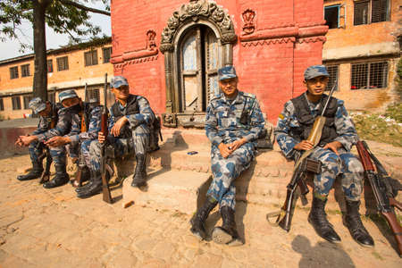 tasked: KATHMANDU, NEPAL - Oct 19: Unknown nepalese soldiers Armed Police Force, Dec 19, 2013 in Kathmandu, Nepal. Minimum age for enlistment is 18 years, tasked with counterinsurgency operations in Nepal.