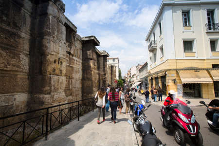 athenians: ATHENS, GREECE - MAY 10, 2014: Athenians and tourists in center of city. Tourism is a decisive sector of hope for Greek economy - In the year Greece receives about 18 million tourists.