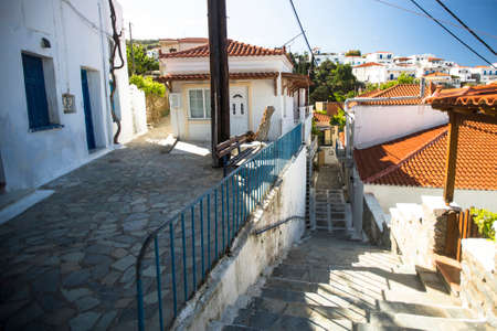 breadth: ANDROS, GREECE - APR 29, 2014: Street of Andros, is the northernmost island of the Greek Cyclades archipelago in the Aegean Sea - area is 380 km2, 40 km long, and its greatest breadth is 16 km.