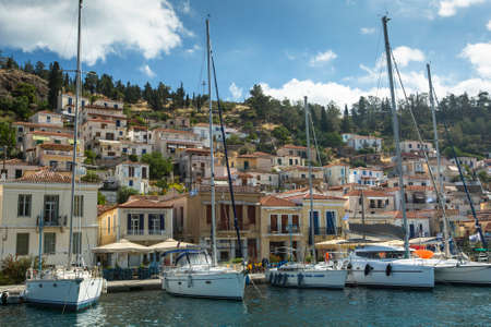 poros: POROS, GREECE - APR 30, 2014: Marina of Poros, is a Greek island in southern part of Saronic Gulf, surface is 31 sq km  3,780 inhabitants. It is a popular weekend destination for Athenian travellers. Editorial