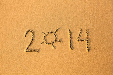 2014 - written in sand on beach texture. photo