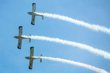 texan: BERLIN, GERMANY - MAY 21, 2014: Aerobatic team 3x Fly Sinthesis Texan Top Class (Wefly team, Italy) demonstration during the International Aerospace Exhibition ILA Berlin Air Show-2014.