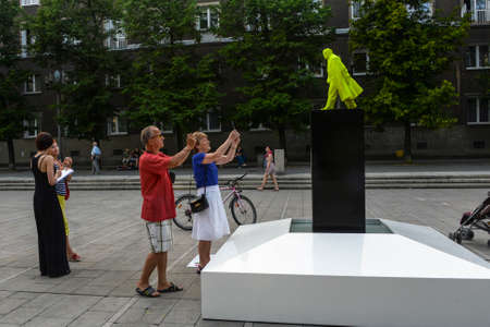 urination: NOWA HUTA, POLAND - JUNE 11, 2014: Fountain of the Future Project as part of the Artboom Krakow Festival (grotesque bright green Vladimir Lenin do urination)
