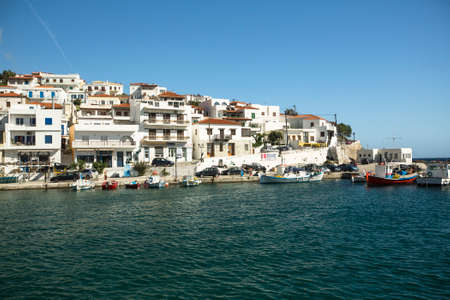 breadth: ANDROS, GREECE - APR 29, 2014: Marina of Andros, is the northernmost island of the Greek Cyclades archipelago in the Aegean Sea - area is 380 km2, 40 km long, and its greatest breadth is 16 km.