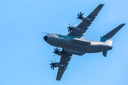 turboprop: BERLIN, GERMANY - MAY 20, 2014: Four-engine turboprop military transport aircraft Airbus A400M (France) demonstration during the International Aerospace Exhibition ILA Berlin Air Show-2014.