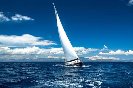 yellow boats: Boat in sailing regatta. Stock Photo