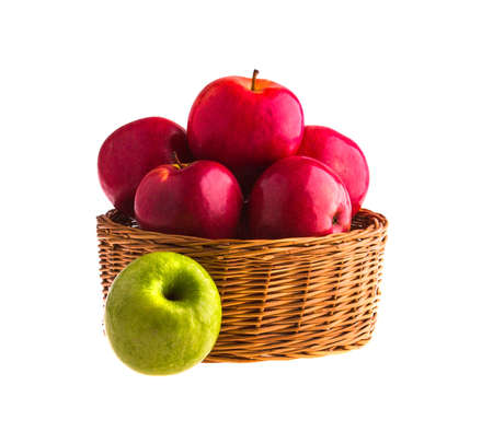 bushel: Red and green apples in a wooden basket