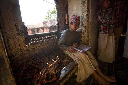 sanskrit: KATHMANDU, NEPAL - DEC 9, 2013: Unknown children doing homework at Jagadguru School. School established at 2013, to let new generation learn Sanskrit and preserve Hindu culture. Editorial