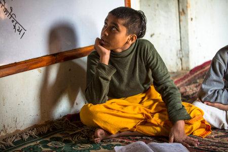 sanskrit: KATHMANDU, NEPAL - DEC 9, 2013: Unknown children in lesson at Jagadguru School. School established at 2013, to let new generation learn Sanskrit and preserve Hindu culture.