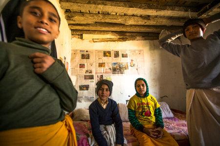 sanskrit: KATHMANDU, NEPAL - DEC 9, 2013: Unknown children after lesson at Jagadguru School. School established at 2013, to let new generation learn Sanskrit and preserve Hindu culture. Editorial