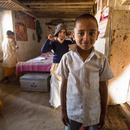 sanskrit: KATHMANDU, NEPAL - DEC 9, 2013: Unknown child after lesson at Jagadguru School. School established at 2013, to let new generation learn Sanskrit and preserve Hindu culture. Editorial