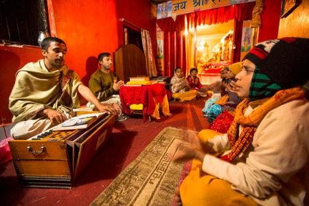 KATHMANDU, NEPAL - DEC 9, 2013: Unknown people during the reading of texts in Sanskrit at Jagadguru School. School established at 2013 to let preserve Hindu culture.