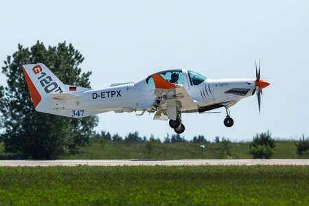 tr: BERLIN, GERMANY - MAY 20, 2014: Two seated training and aerobatic low-wing aircraft Grob G120 TR (Germany), demonstration during the International Aerospace Exhibition ILA Berlin Air Show.