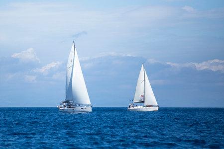 sailboat race: AEGEAN SEA, GREECE - MAY 7, 2014: Unidentified sailboats participate in sailing regatta 11th Ellada 2014 on Aegean Sea.