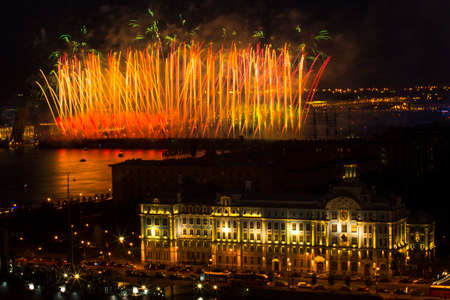 salut: ST.PETERSBURG, RUSSIA - JUN 20, 2014: Light show and firework with a frigate with scarlet sails floating on the Neva River. In 2014, the festival Scarlet Sails celebrates its tenth anniversary.
