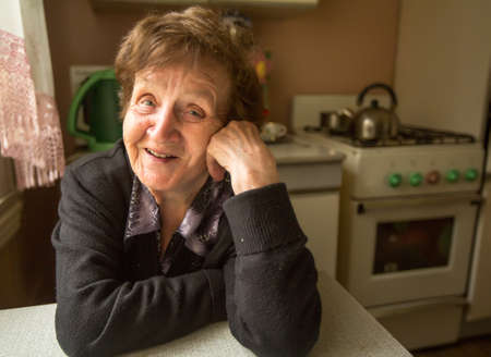 Portrait of a smiling elderly woman in her house. Stock Photo