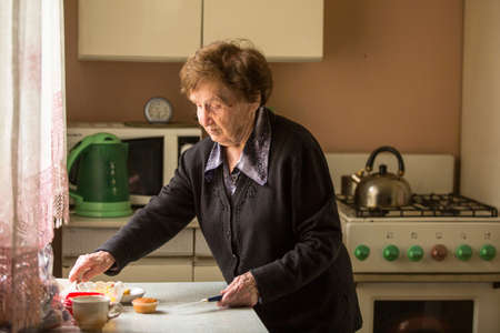 pleasant emotions: Senior woman in the kitchen. Stock Photo