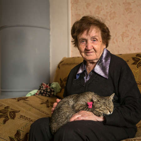 Elderly woman with her cat.  photo
