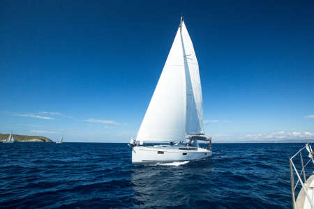 regatta: Yacht sailing at competition.