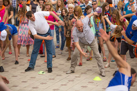 TIKHVIN, RUSSIA - JULY 5, 2014: Head of Tikhvin region Alexander Lazarevich (R) and acting head of administration Tikhvin district Alexander Timkov (L) agitate people to sports during celebration Day of city Tikhvin (631 year)