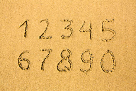 Numbers on a sandy beach (0-9) photo